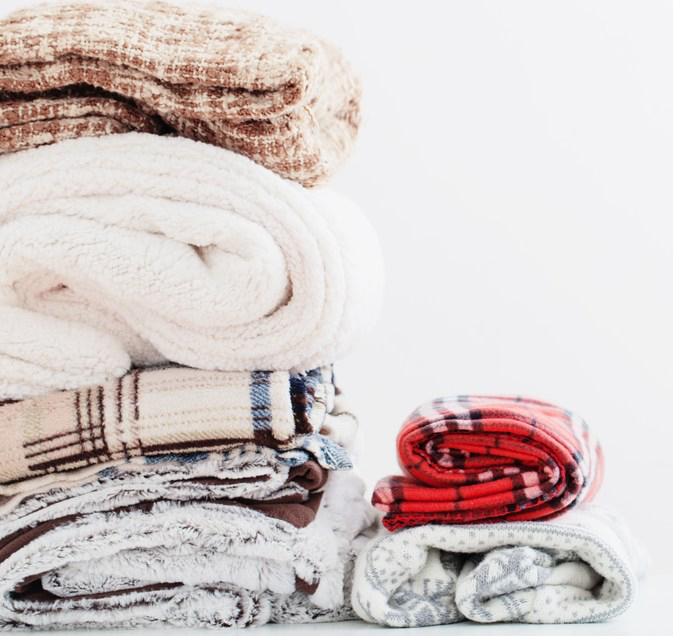pile of blankets on a white background